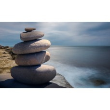 Zen kövek a tengerparton fali vászonkép